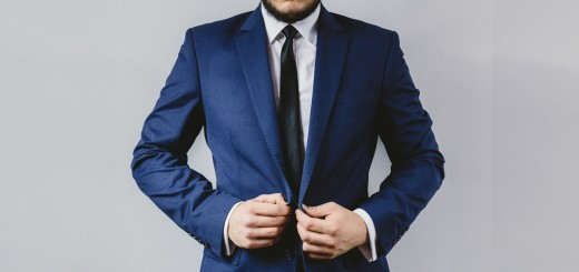 man_putting the suit on